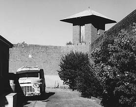 The Prison van and a corner watch tower